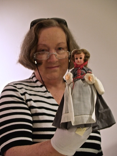 ILL. 9. Curator Mary Brown with Becky Langley Doll. Moravian Museum of Bethlehem. Courtesy AlyssumArts